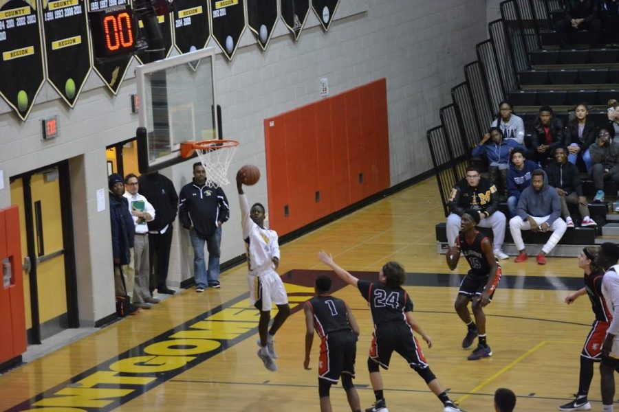 Boys basketball defeats top-20 ranked St. Andrew's Episcopal