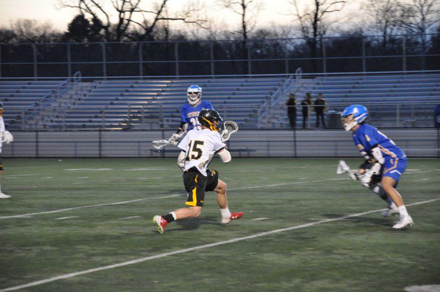 Boys varsity lacrosse team defeats Gaithersburg high school in first game of season