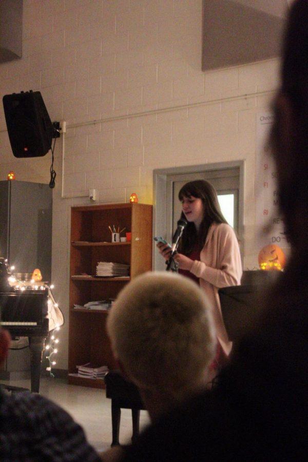 Senior Keira DiGaetano shares her original poetry with the crowd.