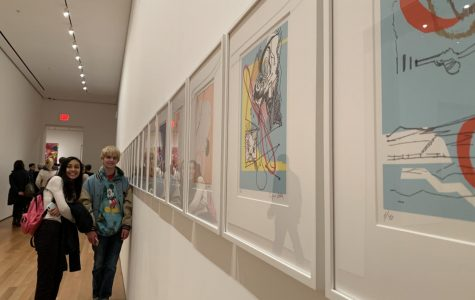 Seniors look at a series of prints at MoMA.