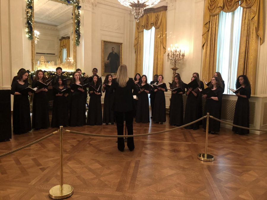 Students sing inside the White House for their open house.