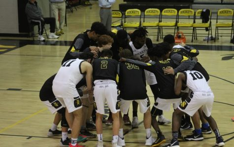 Boys basketball emerges victorious against rival Rockville