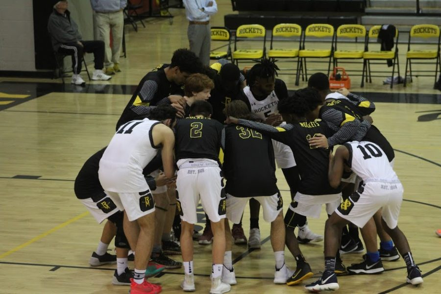 The boys basketball team huddles together before facing against Rockville on January 25. Photo credits to Nyawa Allieu.