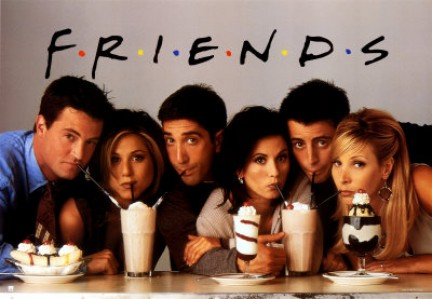 The friends pose in front of milkshakes for a