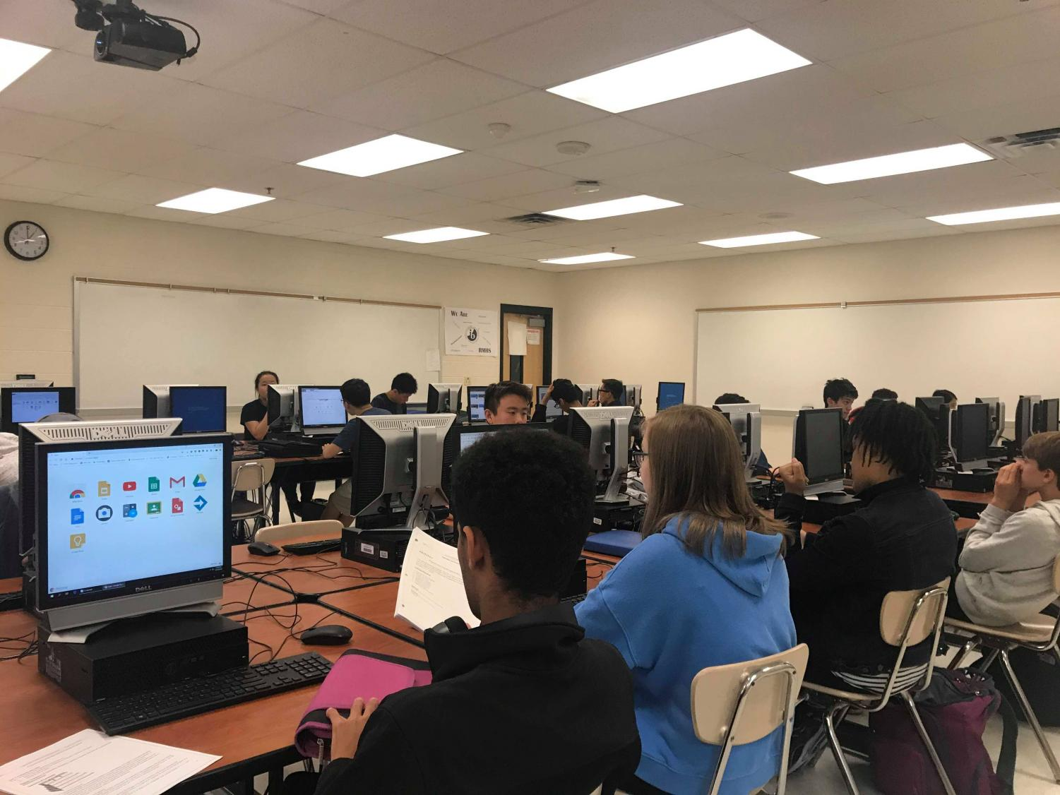 RM students in AP Computer Science complete an assignment in class.