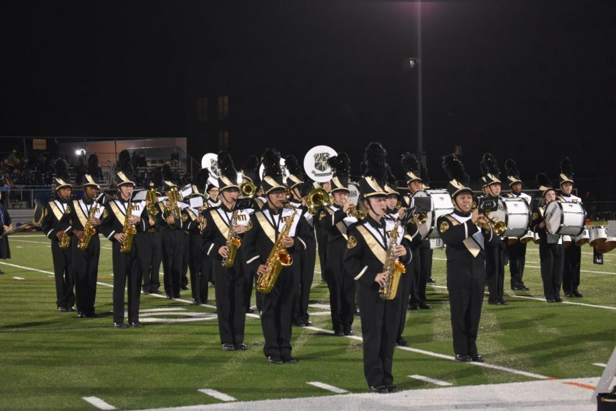 Marching+band+performs+at+halftime+during+the+homecoming+game.