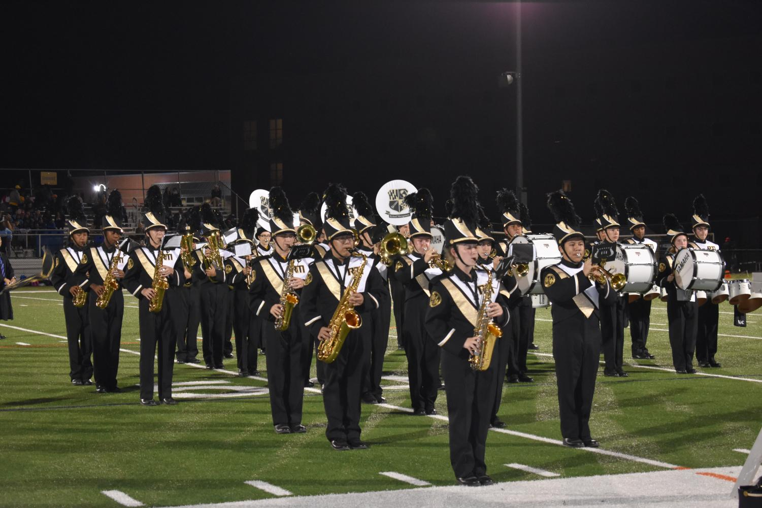 Marching band performs at halftime during the homecoming game.