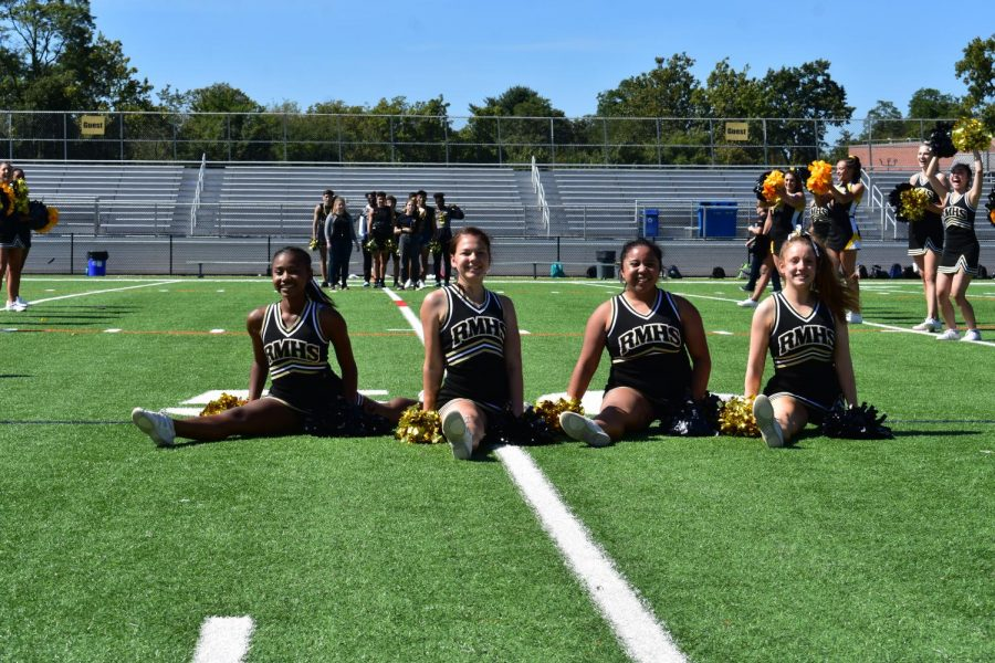 Poms+captains+Brianna+Lacey%2C+Lillian+Matthews%2C+Brigitta+Agung+and+Lucy+Cole+%28from+left+to+right%29+represent+Poms+at+the+fall+pep+rally.