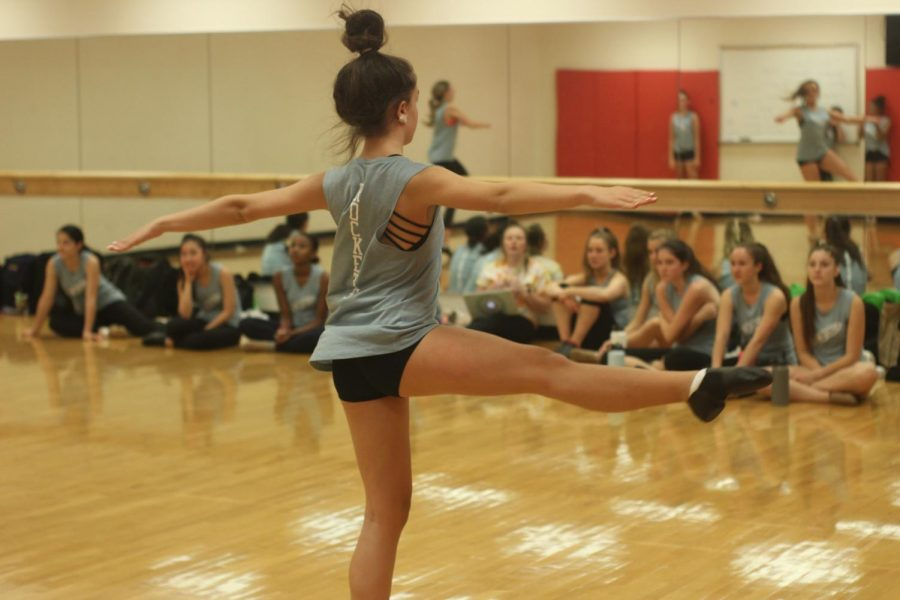 Sophomore Julia Serway performs a fouettè turn during Poms practice in the dance studio in preparation for their competition.