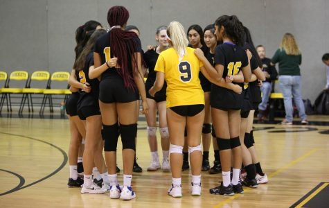 Girls volleyball huddles up during their Senior Night game against Gaithersburg.