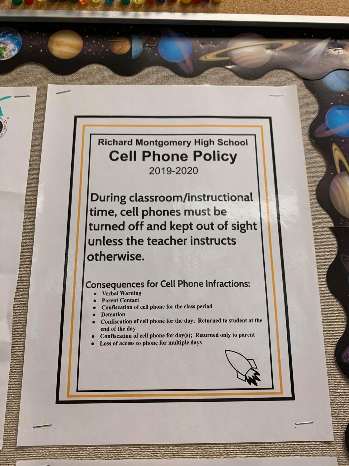 Poster in RM classrooms describing new cell phone policy.