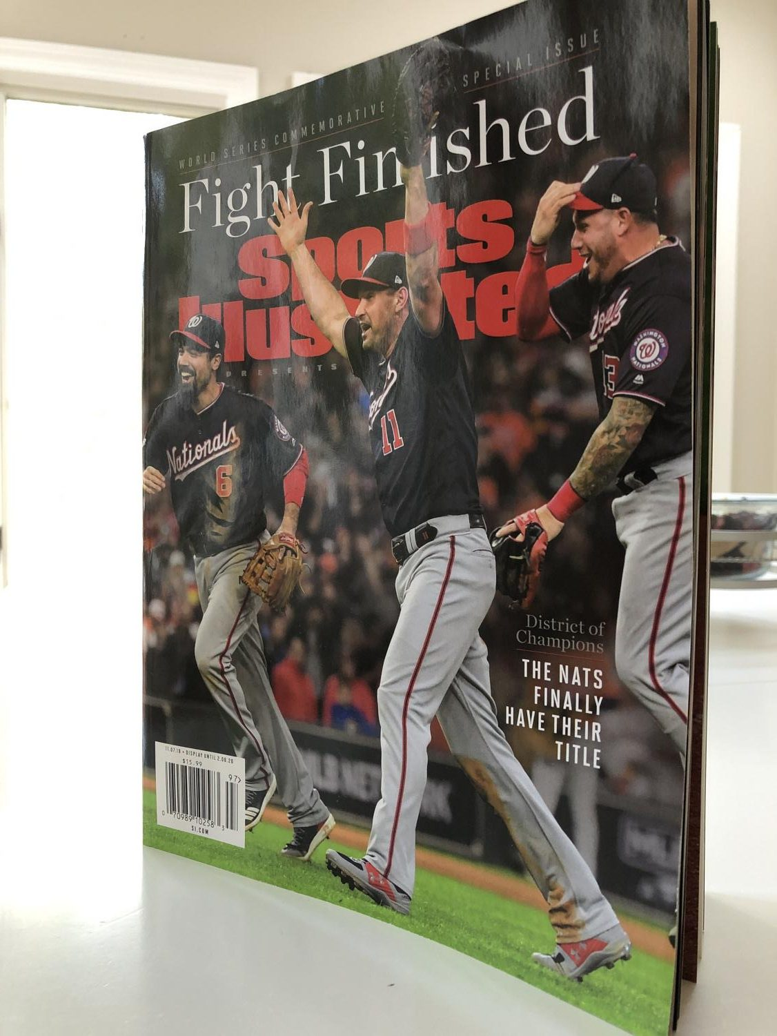 The Nationals players celebrating their victory on the cover of Sports Illustarted