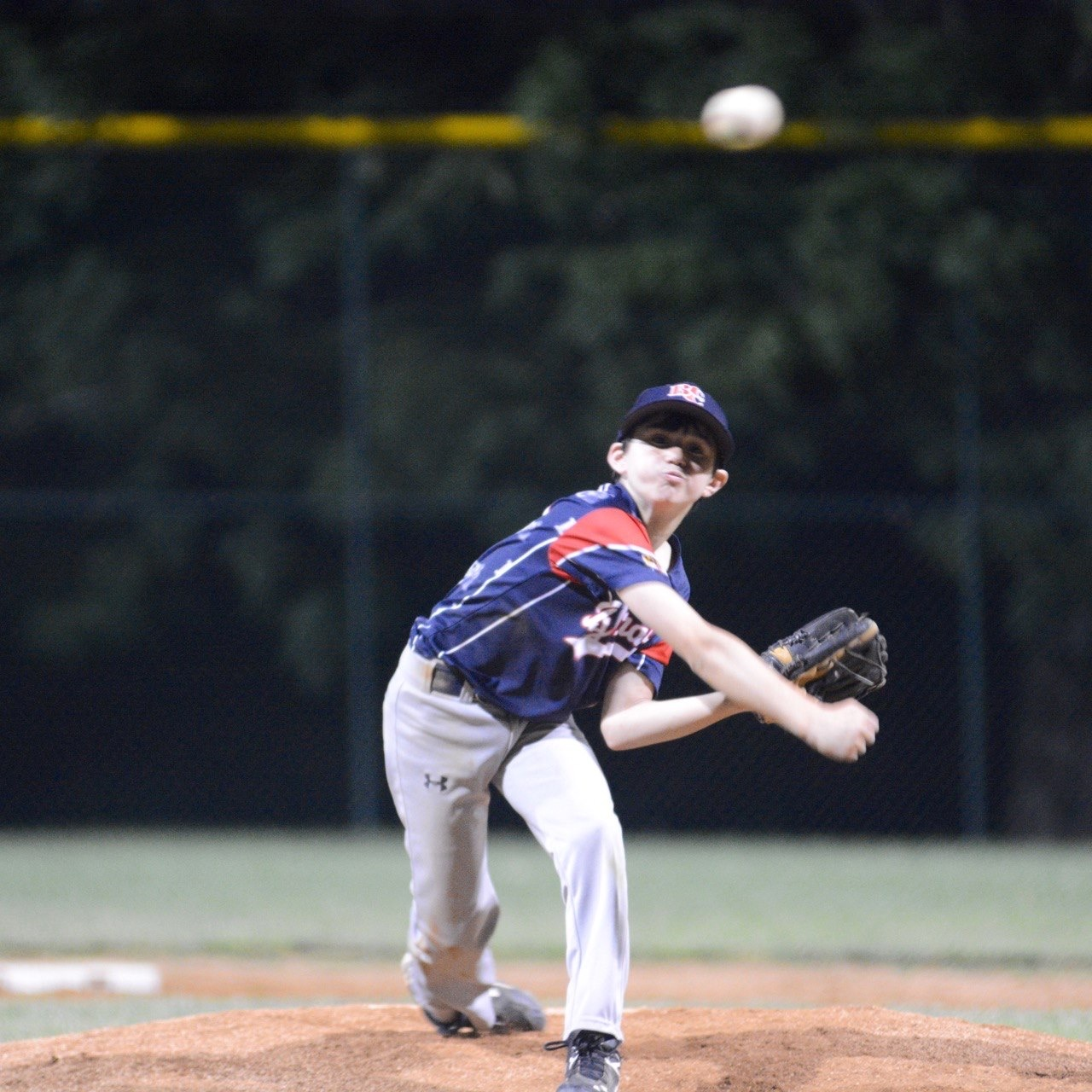 Freshman Zach Wisneski pitching at age 11, before his elbow tendonitis forced him to quit baseball.