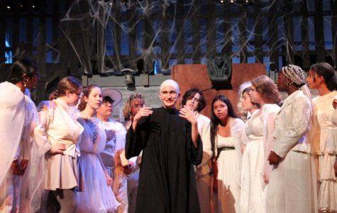 Senior Tudor Postolache lights up the stage in the fall musical as the eccentric matchmaker Uncle Fester.