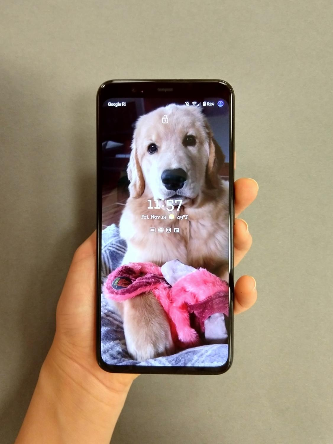 A person displays the lockscreen of the new Pixel 4