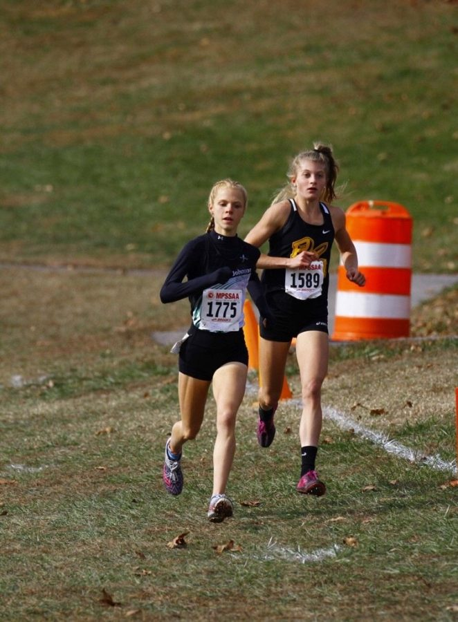 Charlotte Turesson (right) was selected onto the All Decade XC team for MCPS in just her junior year.