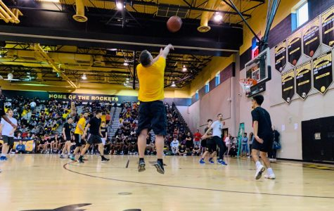 The staff defeat the students 128-121 in the student vs. staff basketball game