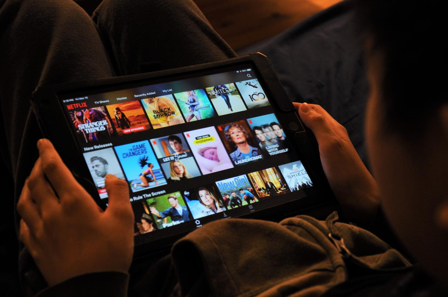 A student scrolls through movies offered on the Netflix streaming service.