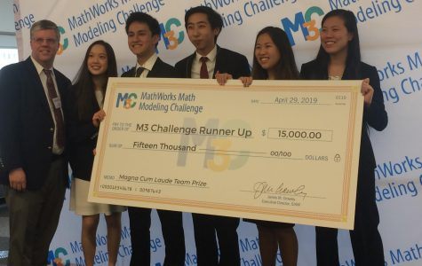 From left, Mr. Davis, Laura Yao, Matthew Kolodner, Jack Yang, Clarissa Xia and Lauren Zhou pose with their $15,000 check.