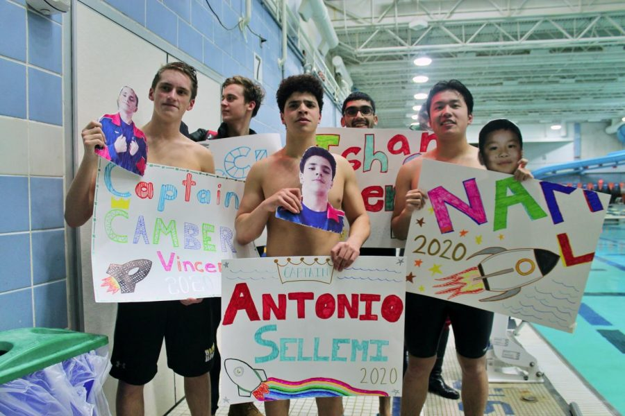 Seniors+Camber+Vincent%2C+Jack+Bowman%2C+Antonio+Sellemi%2C+Ishaan+Oberoi+and+Nam+Lam+%28left+to+right%29+show+off+their+posters+at+RM+Swim+and+Dive%27s+Senior+Night+against+Rockville+High+School+on+Saturday%2C+January+25.