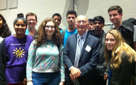 Students pose with Marty Weiss after his presentation on the Holocaust.