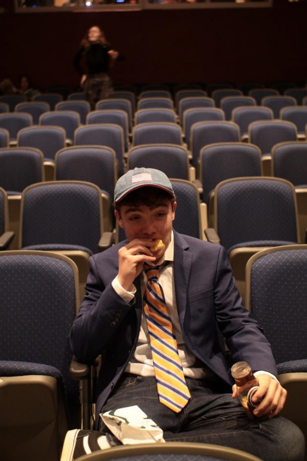Director and Senior Adam Winchenbach takes a personal moment before the show.