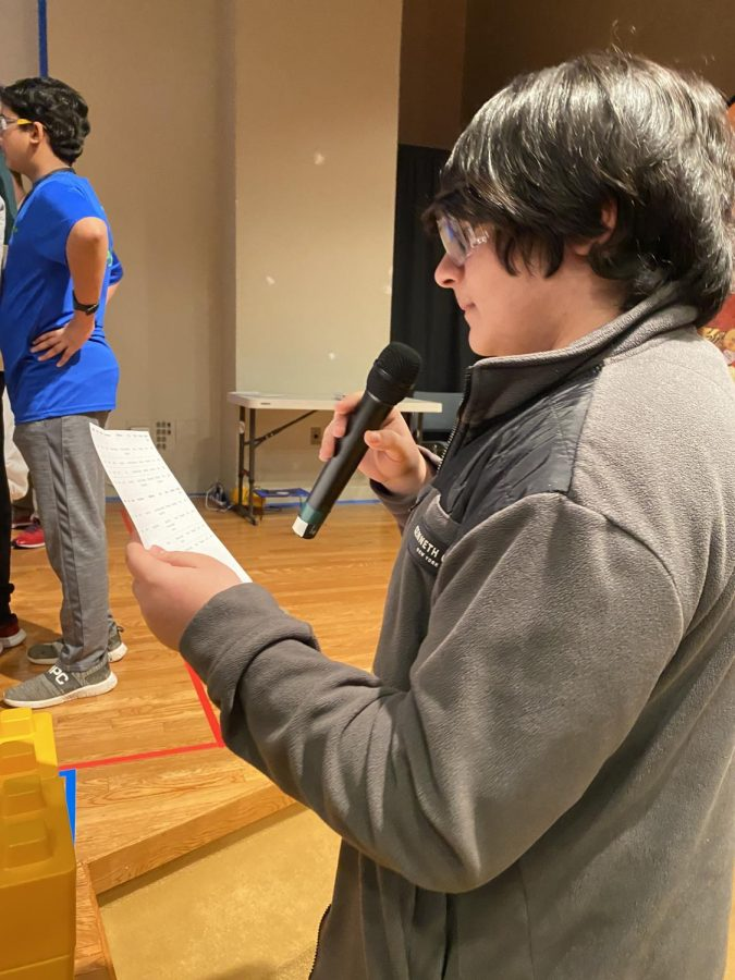 Freshman Shawn Pourifarsi looks over the match schedule in order to prepare for his role as game announcer at the Capitol Tech University robotics qualifier on Feb. 8. Pourifarsi is a member of RM Robotics, the team hosting the qualifier.