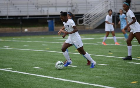 Alexander dribbles the ball upfield during a Varsity match in the fall.