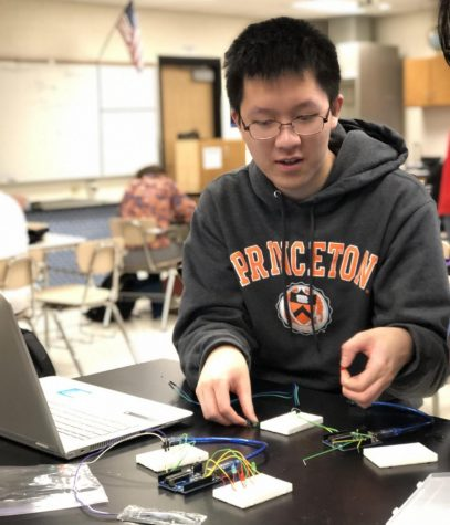 Senior Eric Yi builds a temperature sensing device for the Maryland regional Science Olympiad competition.
