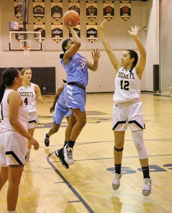 Talia Kouncar jumps to block a lay-up.