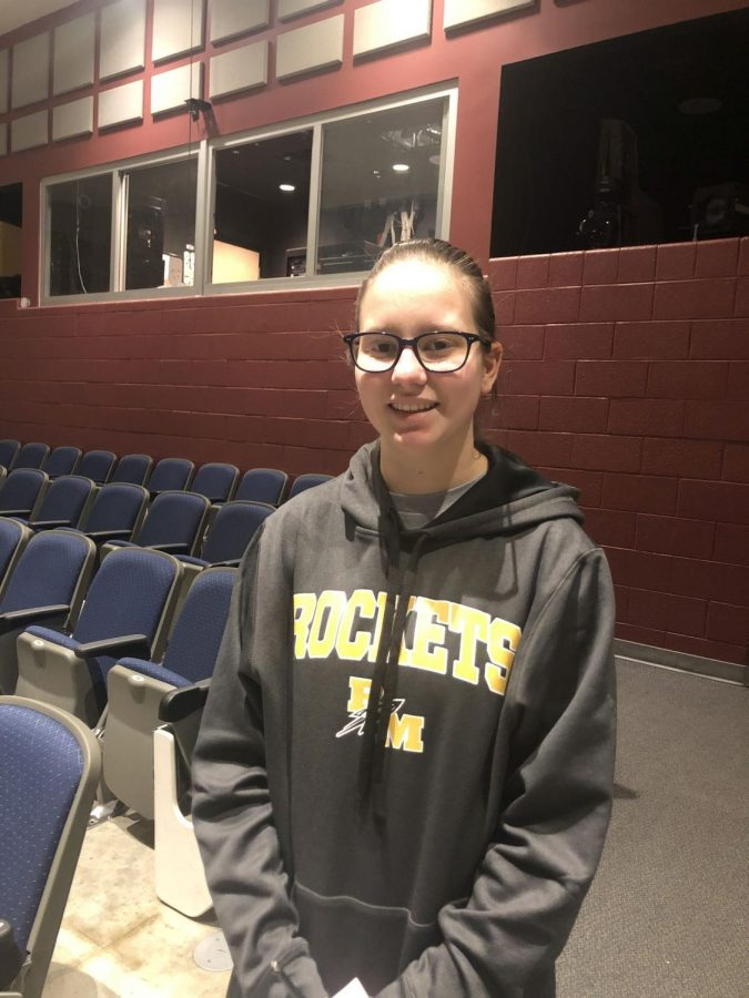 Saffel smiles in the auditorium during One Acts rehearsal.