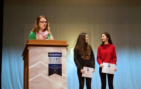 Seniors Katie Kolodner and Laura Yao share a moment as Ms. Melissa Taylor recognizes their achievements.