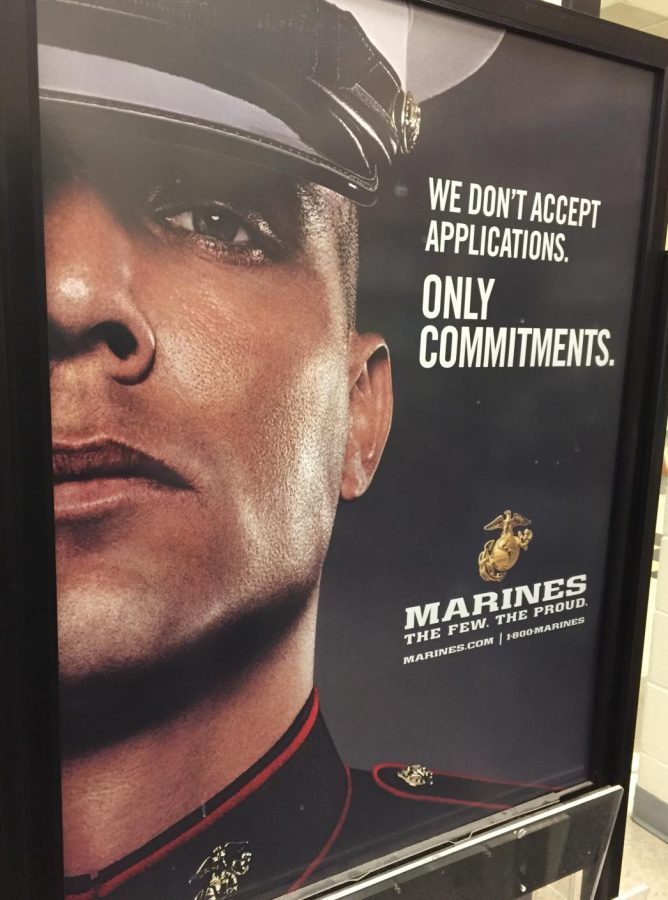 A poster in the Career Center advertises joining the Marine Corps after high school.