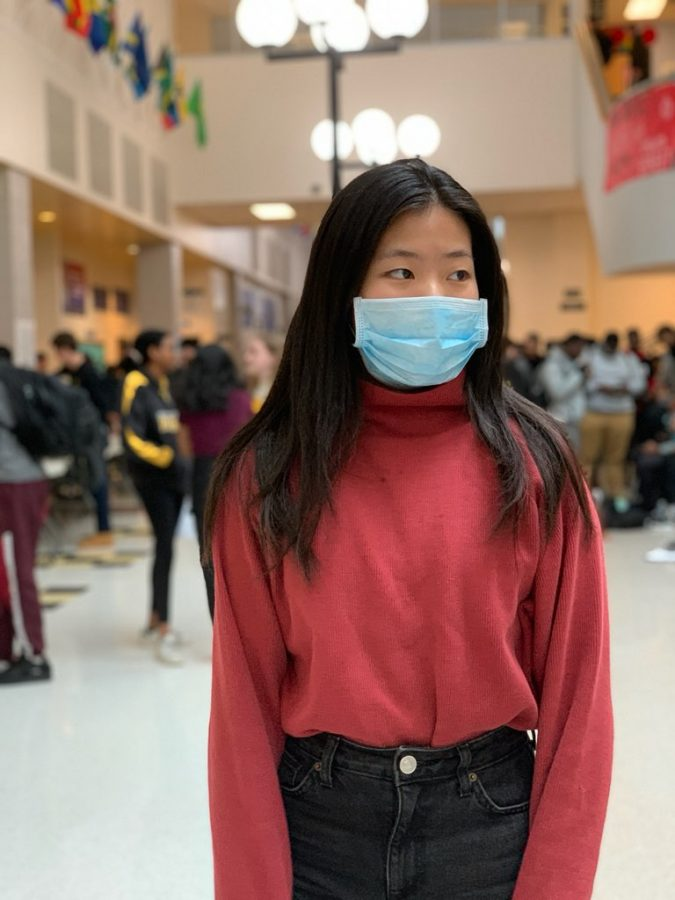 RM+sophomore+Emily+Wu+wears+a+mask+to+school+as+protection+against+the+recent+outbreak+of+COVID-19+in+Montgomery+County.+