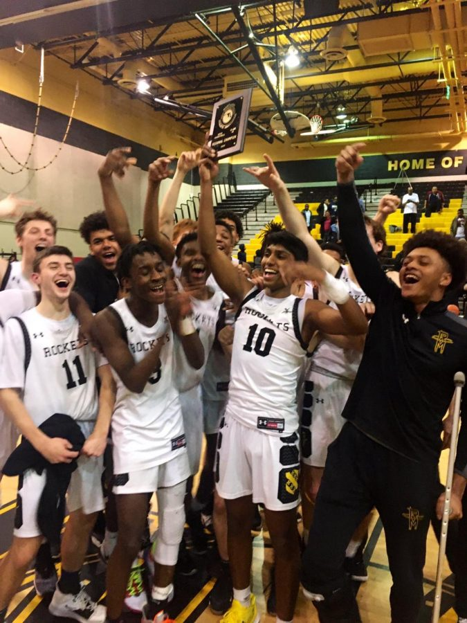 Boys' basketball celebrates their win as the 2020 4A West Region II Champions.