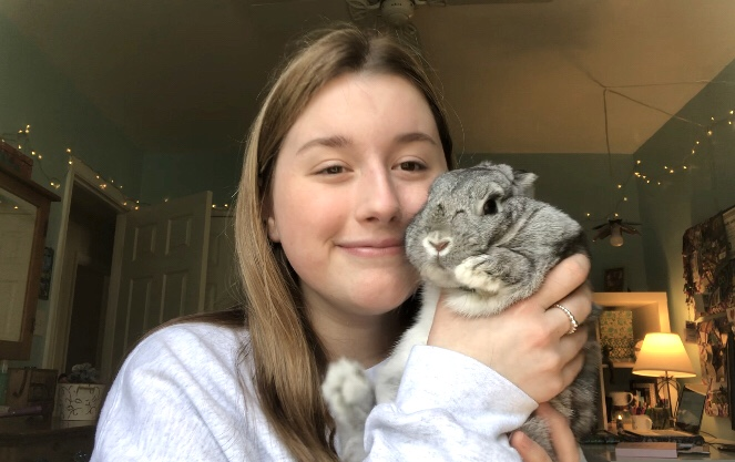 Junior Grace Burwell has been able to spend more time with pets and novels during the quarantine.