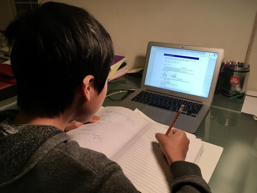 A student studies independently for school during the age of COVID-19.