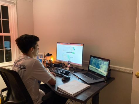 Junior Lucas Corea works at his desk setup, as he logs in his running miles for the day.