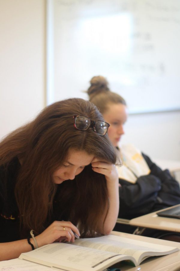 Prior to the school shutdown in March, RM graduate Lydia Levy studies in class.