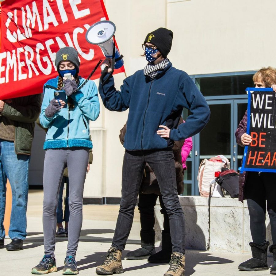 Clemans-Cope (middle holding the bullhorn) protesting at the County Executive Office on March 5.