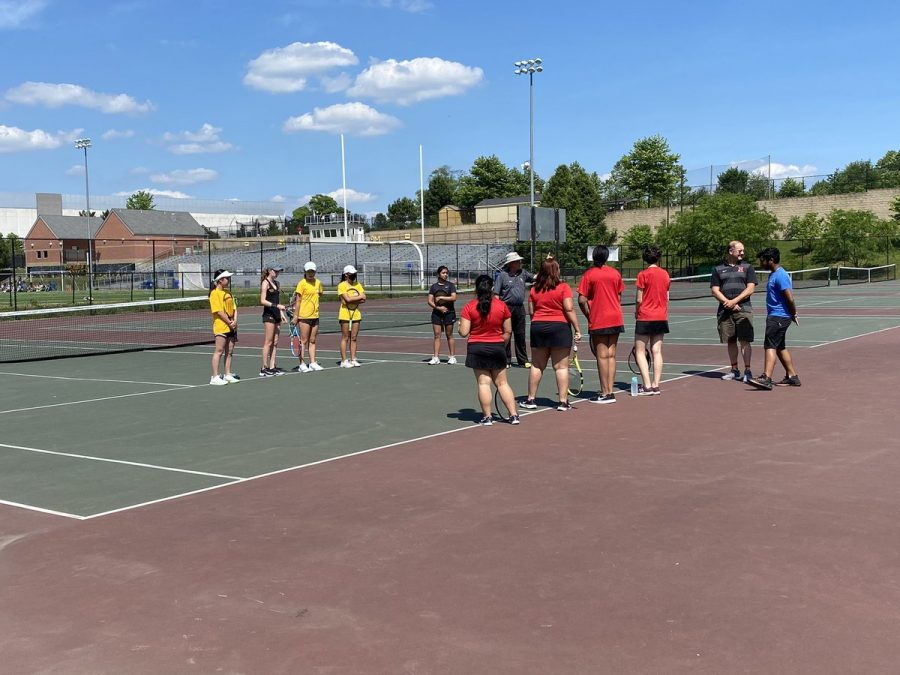 The girls tennis team (yellow) sweeped Northwest in route to a fourth consecutive 7-0 victory.
