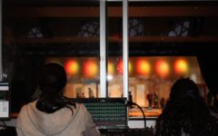 Black Maskers crew members working in the sound and lighting booth. Photo by Ella Koenig