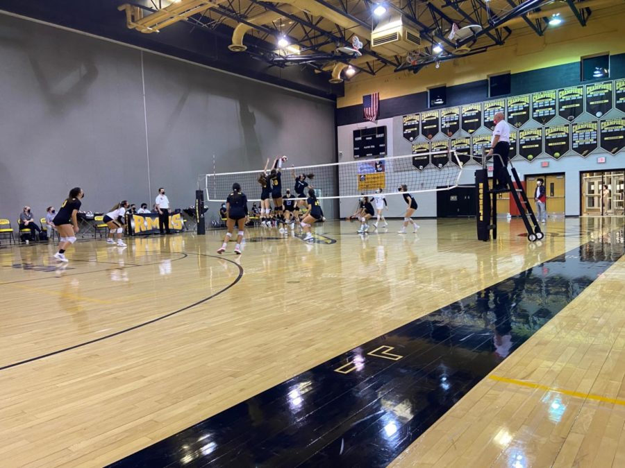 BLOCKED! Corinne Howard (Fr.) and Emma Djordjevic (Fr.) extend up to block a spike attempt by a Whitman opponent. Richard Montgomery defeated Whitman in a sweep of sets, 3-0. We fought hard and got the job done tonight. said freshman Corinne Howard.
