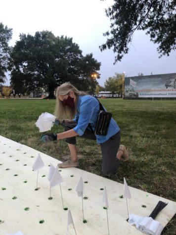 Artist Suzanne Brennan Firstenberg installs an artistic tribute to lives lost during the pandemic.