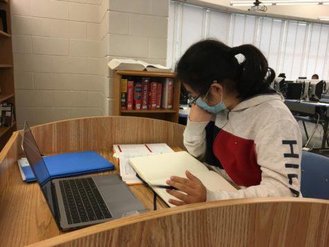 Junior Evelyn Shue studies for a test in the Media Center.
